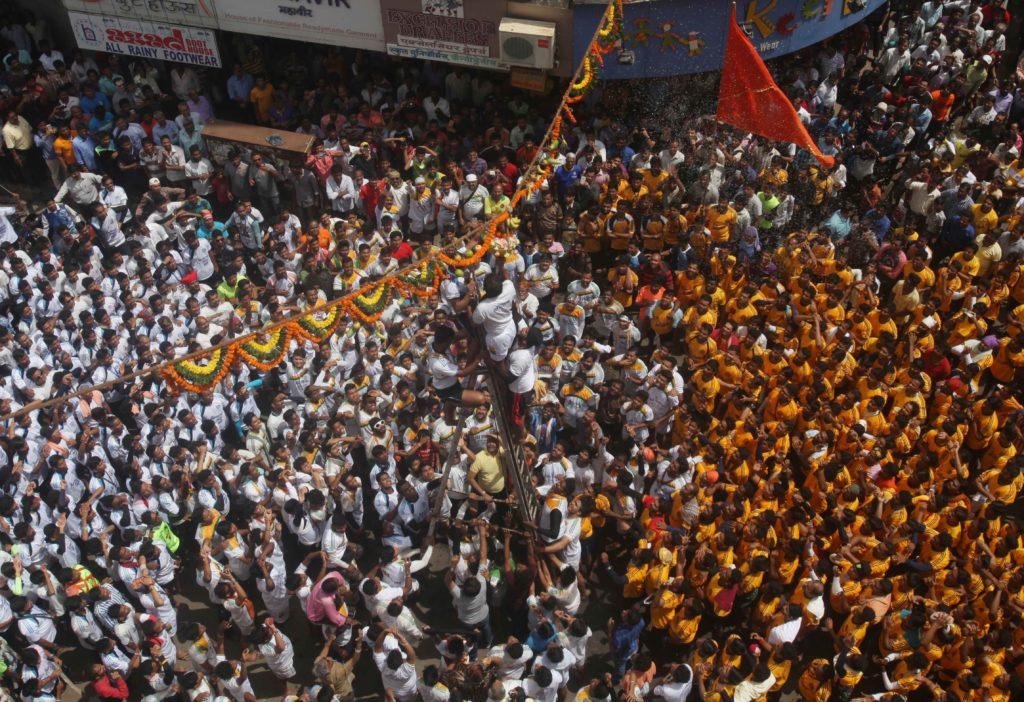 "MUMBAI: Curd spills devotees form a human pyramid and break the ""Dahi handi"", an earthen pot filled with curd, as part of celebrations to mark Janmashtami in Mumbai, on Thursday Photo by Imtiyaz Shaikh"