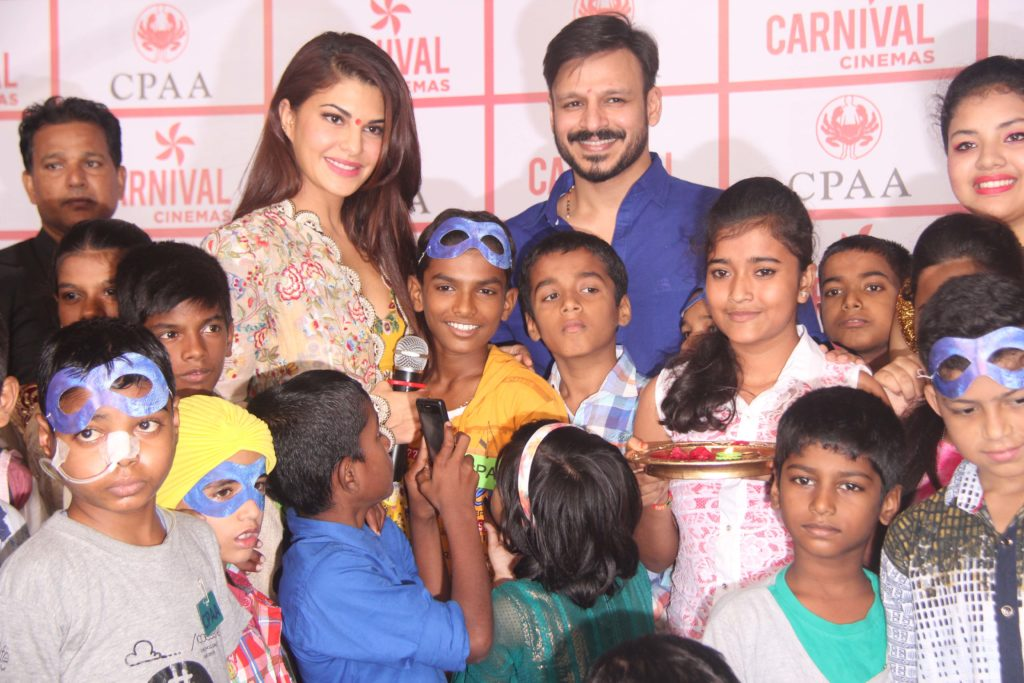Jacqueline Fernandes and Vivek Oberoi with cancer patients at the CPAA event at  Carnival Imax, Wadala