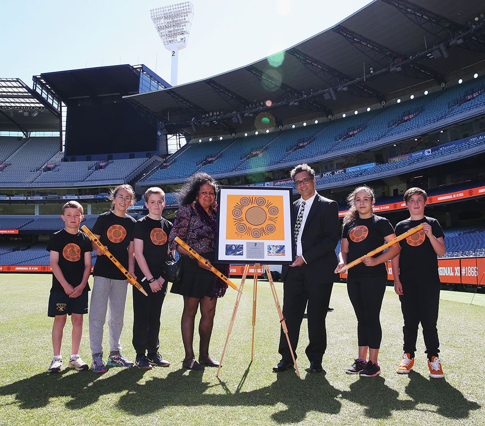 greg-de-moore-and-artist-clarke-with-children-and-match-day-stumps